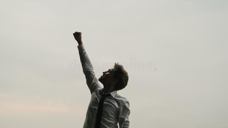 Young businessman celebrating success royalty free stock photo
