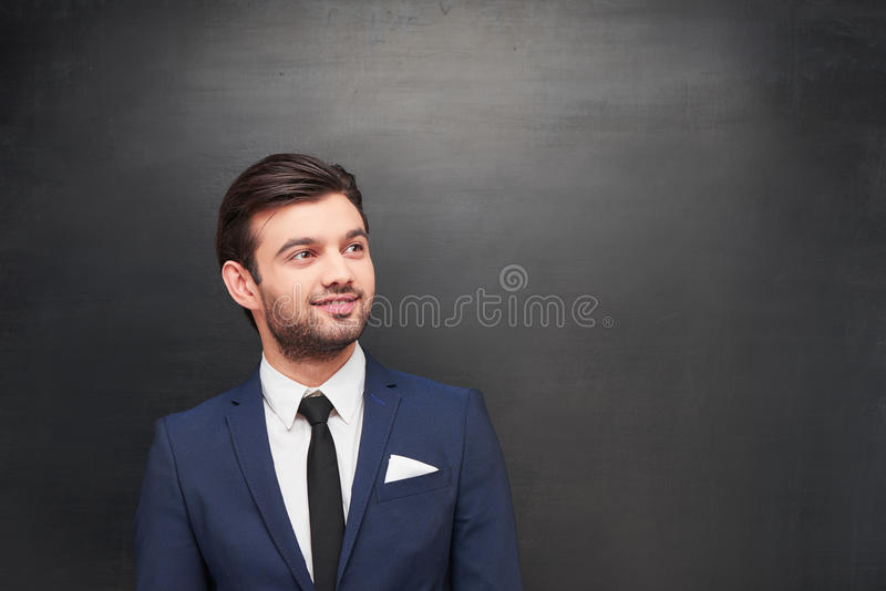 Young businessman on chalkboard background stock photography
