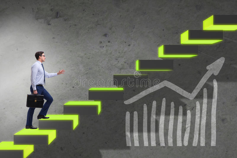 The young businessman climbing career ladder. Young businessman climbing career ladder royalty free stock images