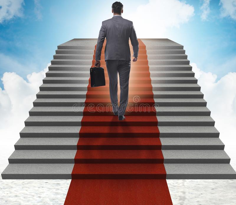 The young businessman climbing stairs and red carpet into sky. Young businessman climbing stairs and red carpet into sky stock images