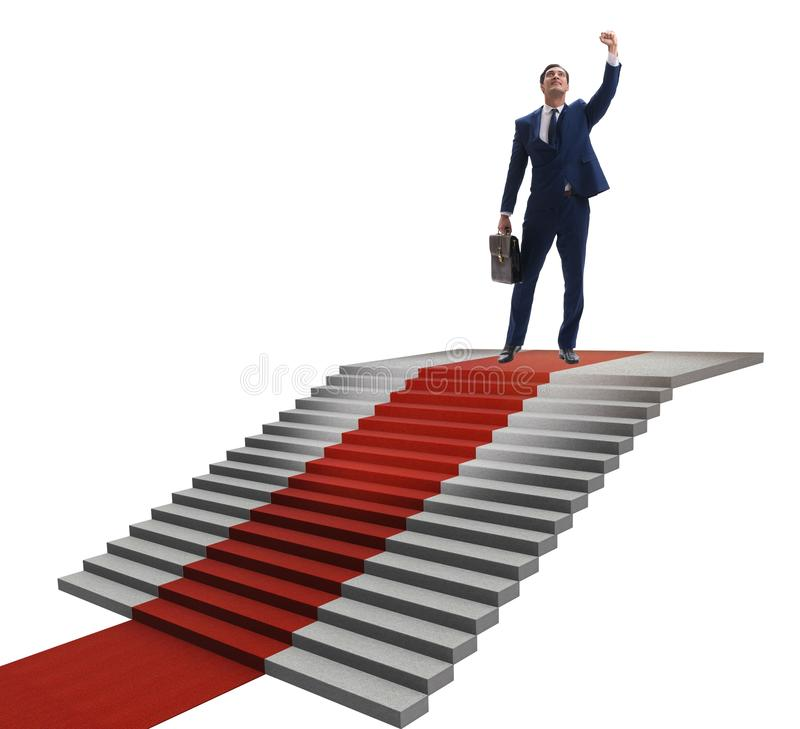 Young businessman climbing stairs and red carpet on white backgr. Ound stock images