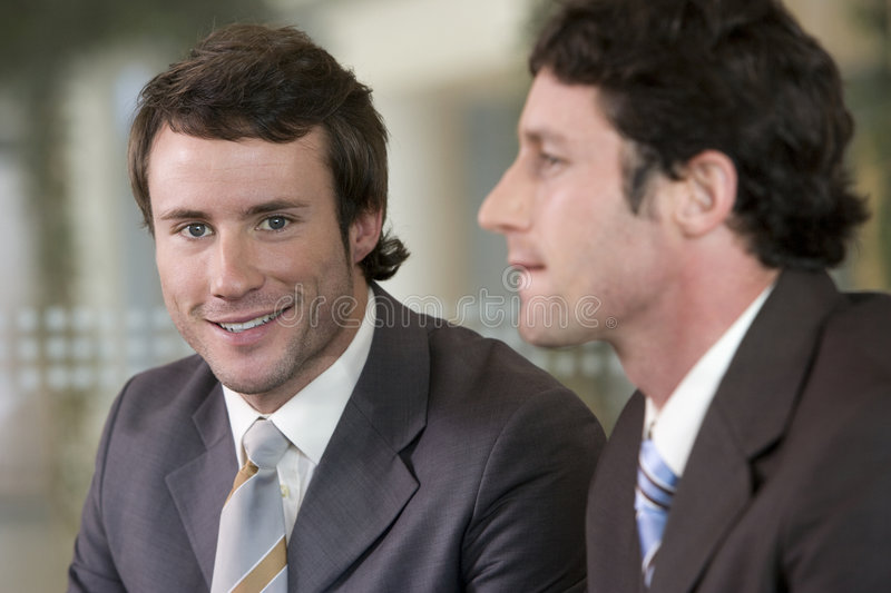 Young businessman with colleague stock photo