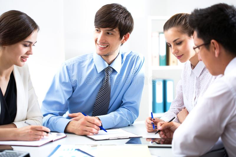 Young businessman with colleagues. In modern office royalty free stock photos