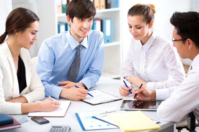 Young businessman with colleagues. In modern office royalty free stock images