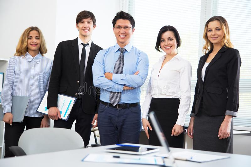 Young businessman with colleagues. In modern office stock photography