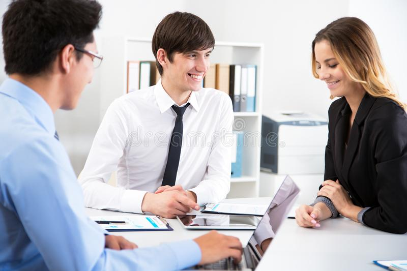 Young businessman with colleagues. In modern office stock photo