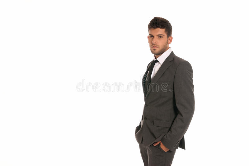 Young businessman copy-space look hands in pocket stock image