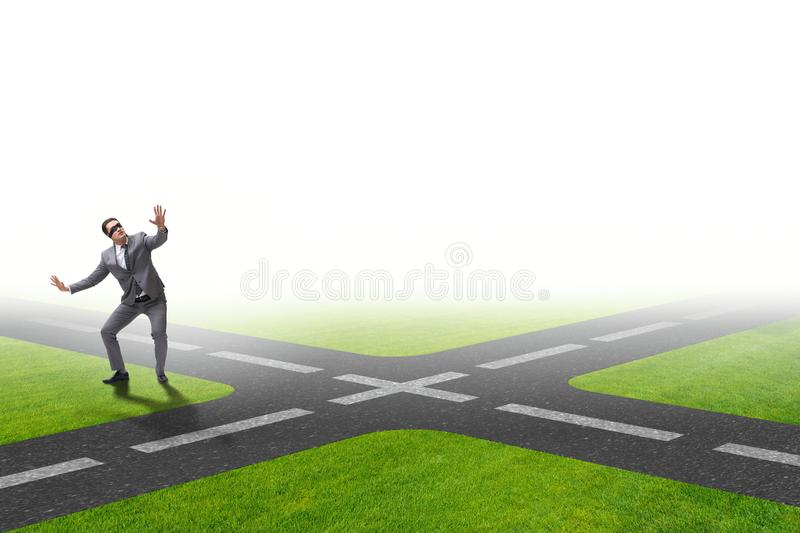 The young businessman at crossroads in uncertainty concept. Young businessman at crossroads in uncertainty concept stock photography