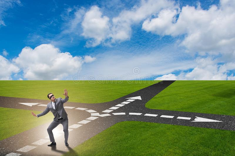 The young businessman at crossroads in uncertainty concept. Young businessman at crossroads in uncertainty concept royalty free stock photography