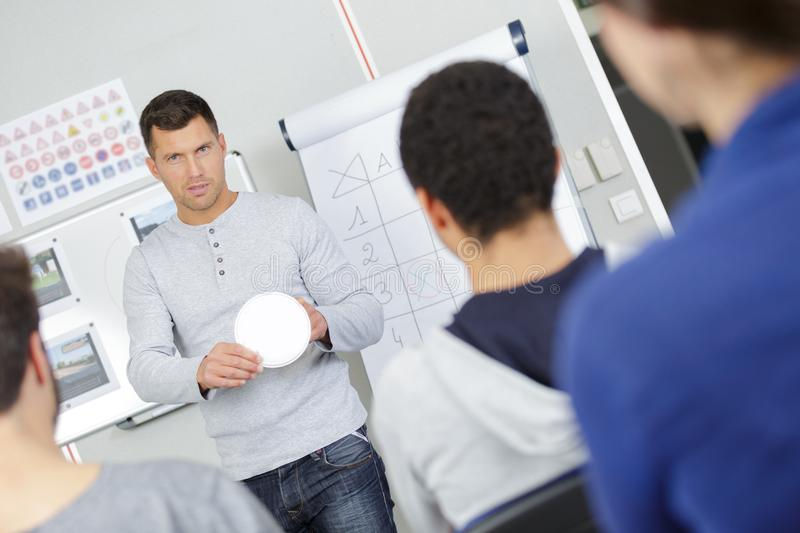 Young businessman discussing business plans at white board stock photos