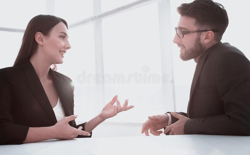 Business people in modern office. Young businessman discussing something with his colleague royalty free stock photos