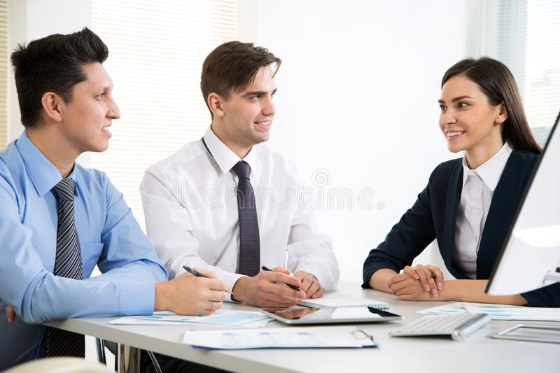 Businessman explains to colleagues a new project. Young businessman explains to colleagues a new project stock images