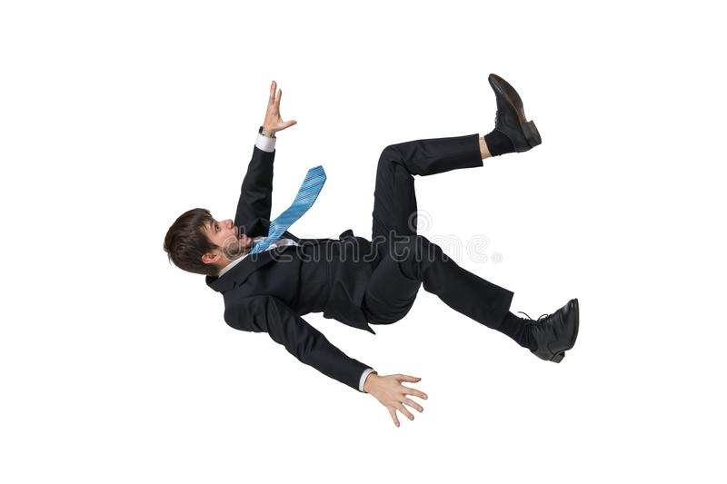 Young businessman falling down in free fall. Isolated on white background stock images