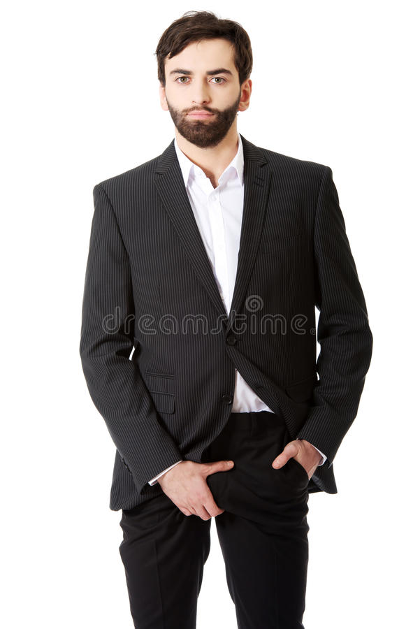 Young businessman feeling pain in his crotch. stock photo