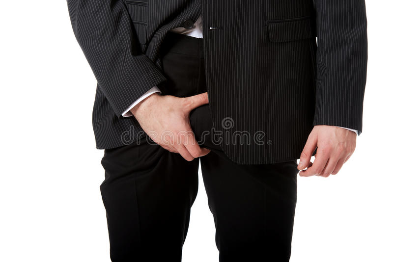 Young businessman feeling pain in his crotch. royalty free stock photos