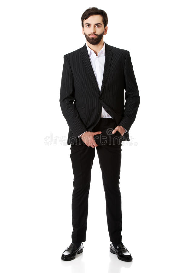 Young businessman feeling pain in his crotch. royalty free stock photo