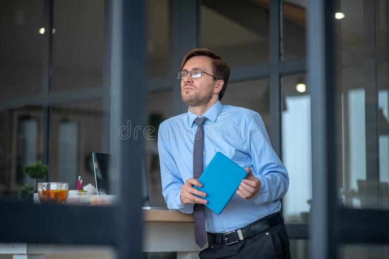 Young businessman feeling thoughtful while planning project stock images