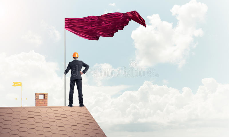 Young businessman with flag presenting concept of leadership. Mi royalty free stock image
