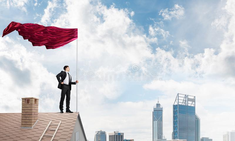 Young businessman with flag presenting concept of leadership. Mixed media royalty free stock photos