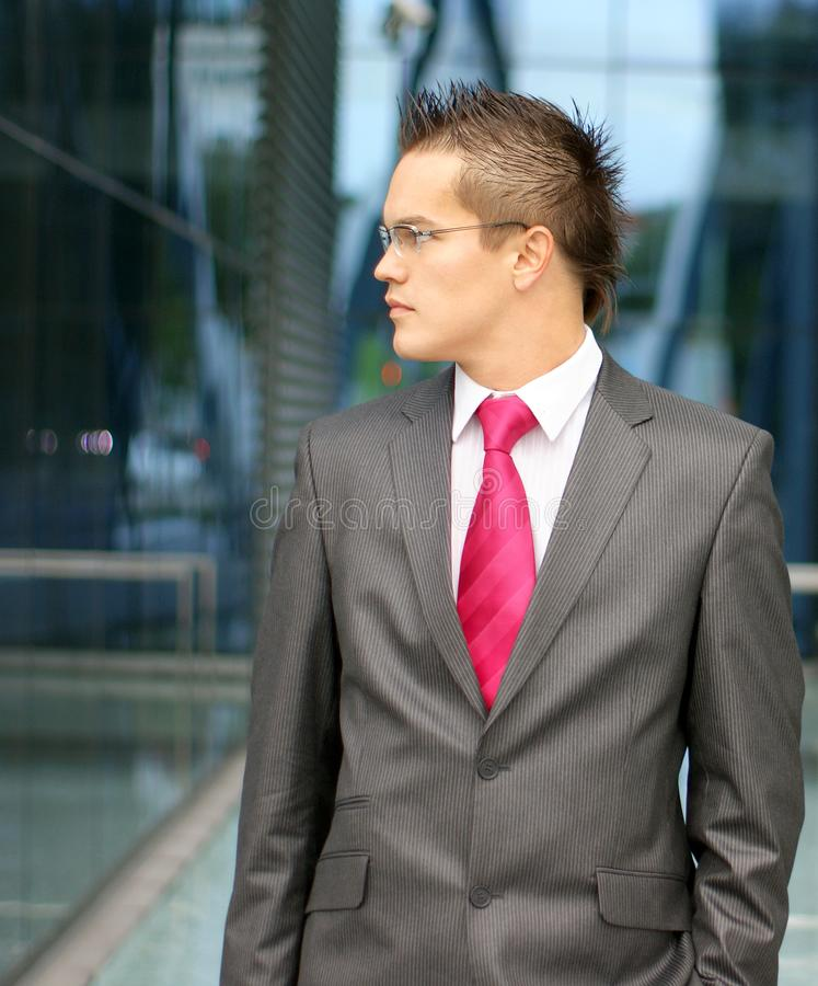 A young businessman in formal clothes