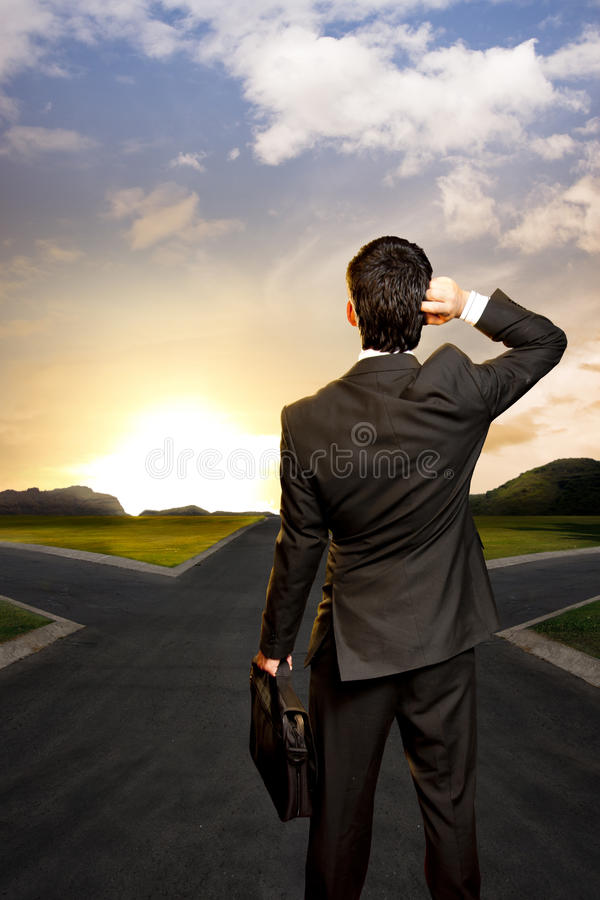 Download Young Businessman In Front Of A Crossroad Stock Image - Image: 25350399