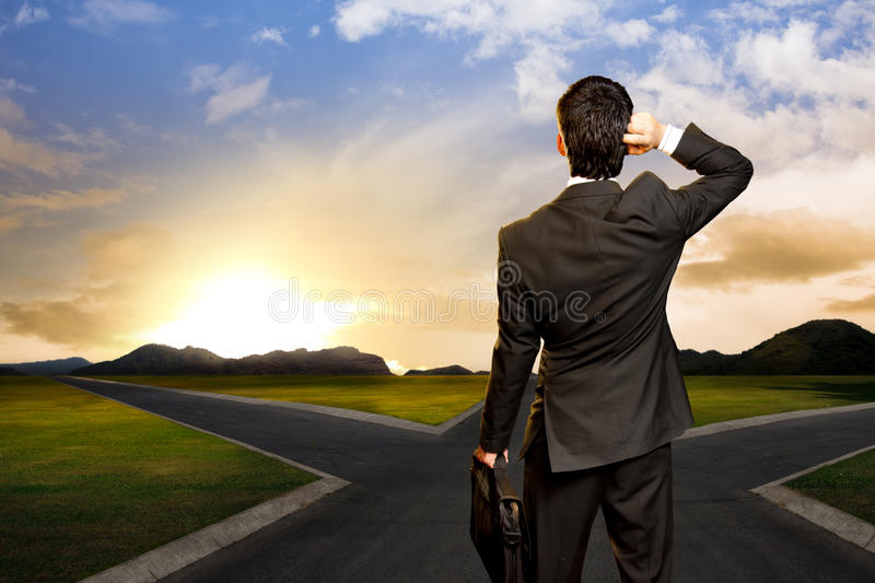 Download Young Businessman In Front Of A Crossroad Stock Image - Image: 25350763
