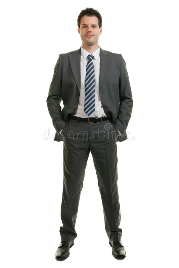 Young businessman in full length standing isolated on white background. Business, office and success concept stock photography