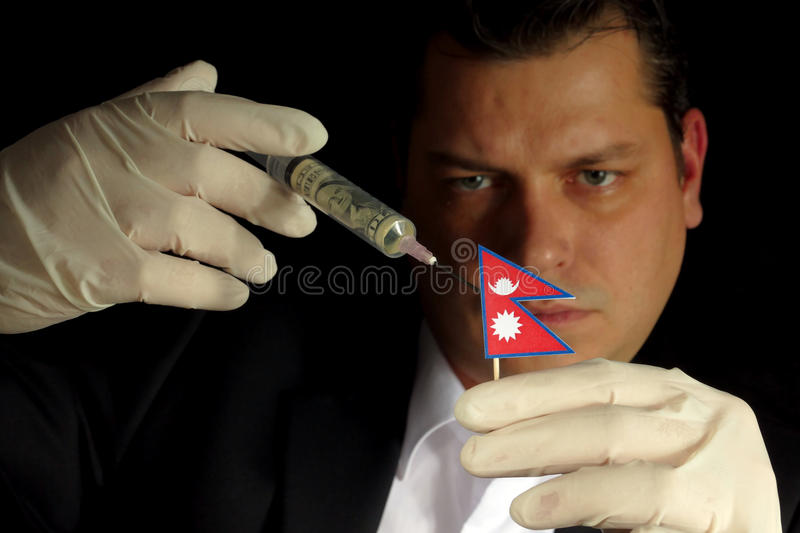 Young businessman gives a financial injection to Nepalese flag i royalty free stock image