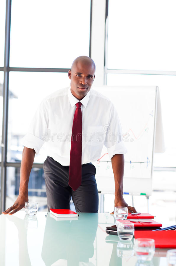 Young businessman after giving a presentation royalty free stock photography