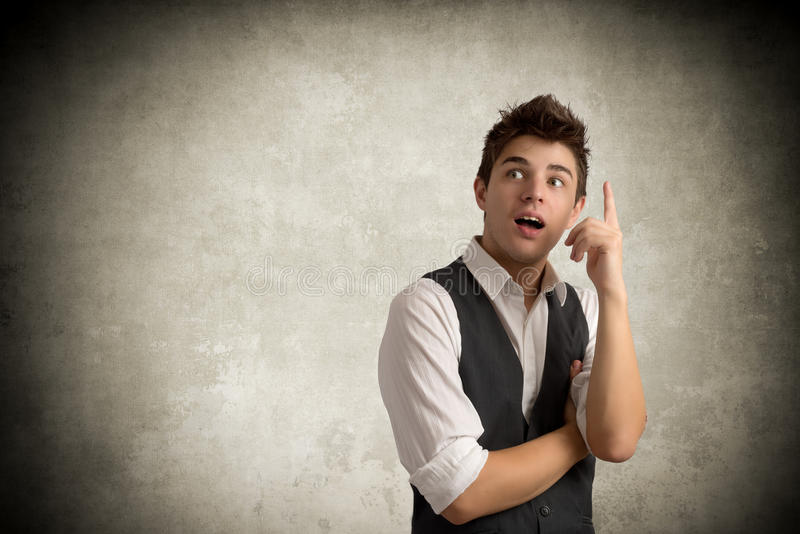Young Businessman on gray royalty free stock image