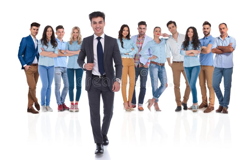 Young businessman group leader walks in front of the team stock images