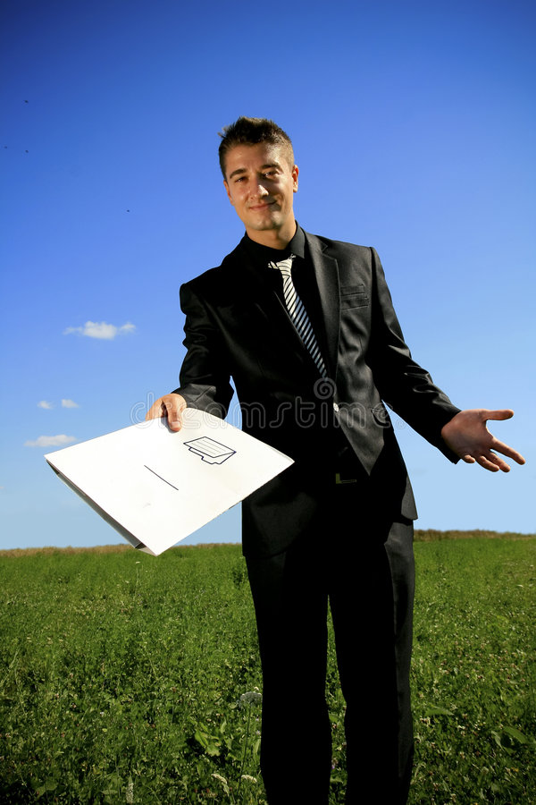 Download Young Businessman Handing A Folder Stock Photo - Image: 6629228