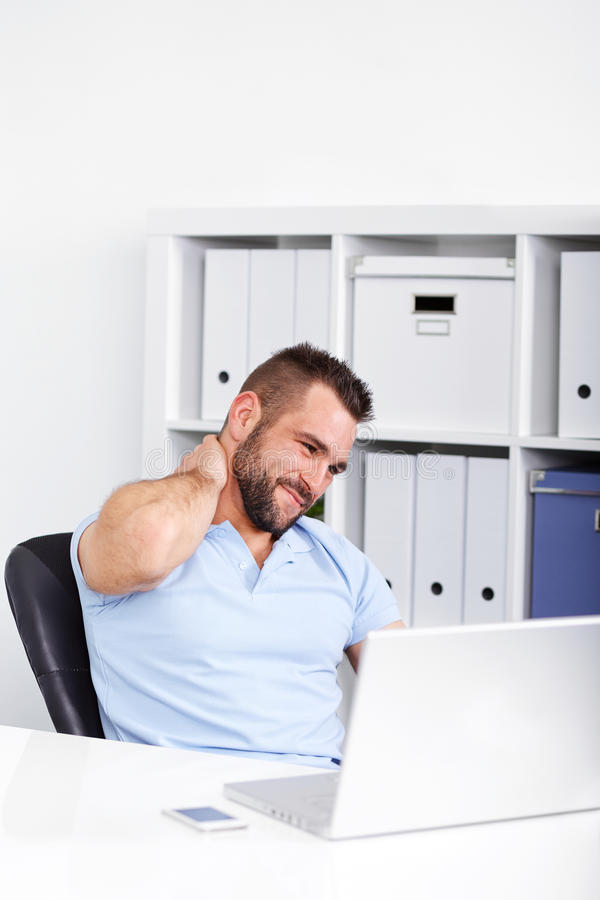 Young businessman has pain of the cervical at work stock photos