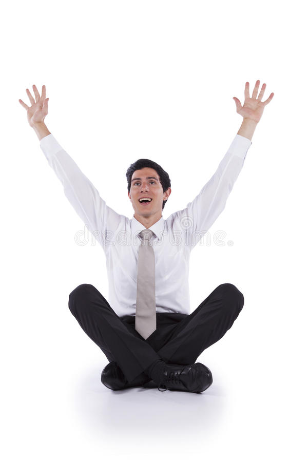 Young Businessman with his arms up stock photo