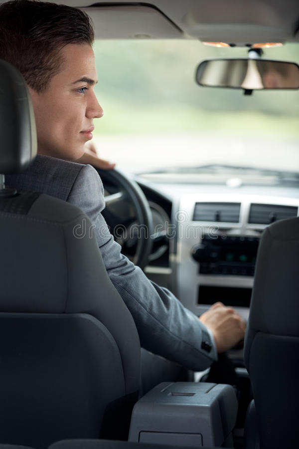 Young businessman in his car stock photos