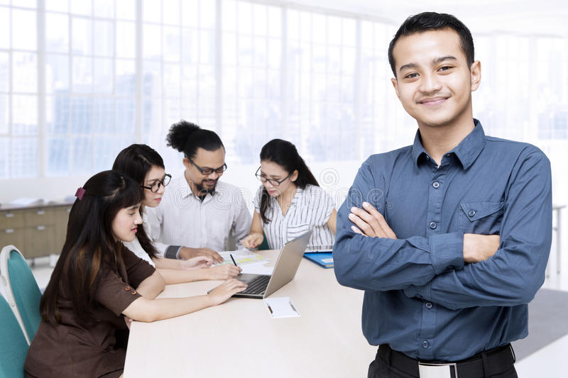 Young businessman and his team royalty free stock photos
