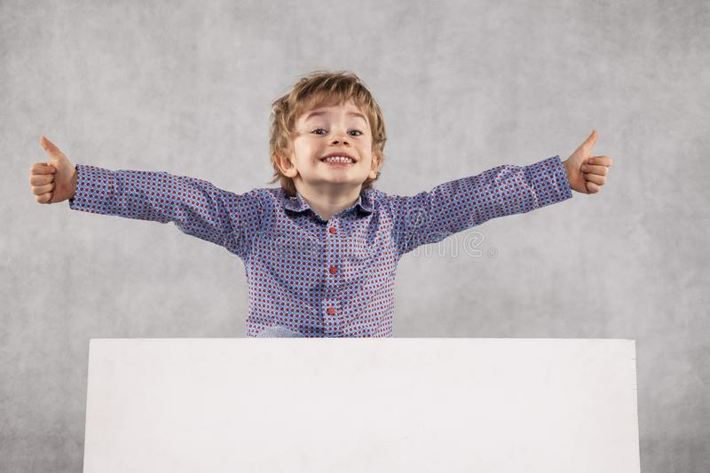 Young businessman holding a board with space for advertising, co royalty free stock photography