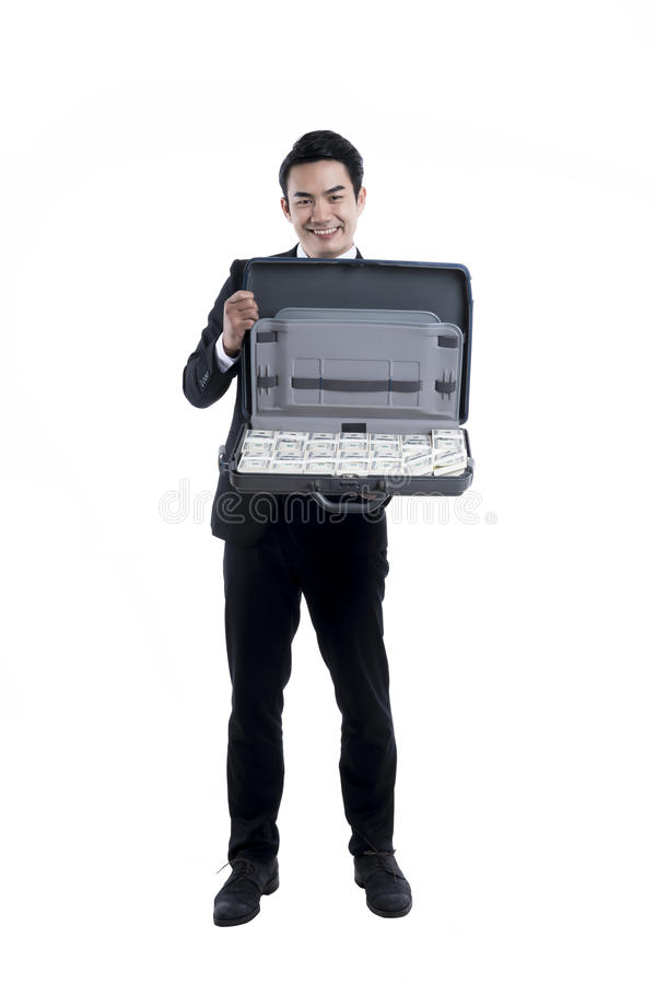 Young businessman holding a briefcase with banknote royalty free stock photo
