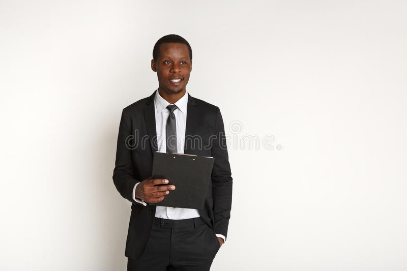 Young businessman holding clipboard isolated royalty free stock images