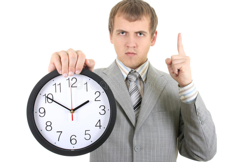 Download Young Businessman Holding A Clock Stock Image - Image: 17355635