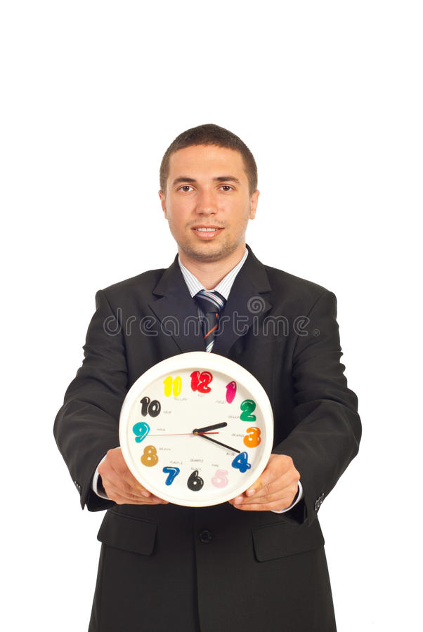Young businessman holding clock royalty free stock photos