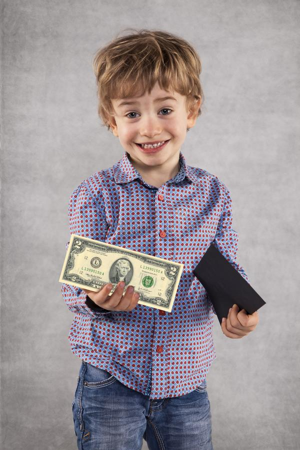 Young businessman holding an envelope with a bribe, money in a h. And stock photo