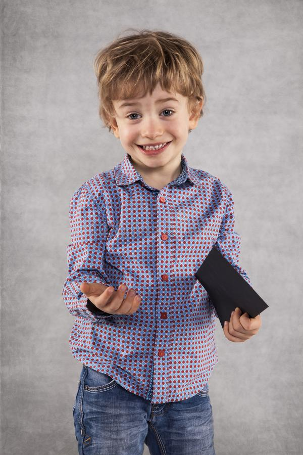 Young businessman holding an envelope with a bribe royalty free stock image