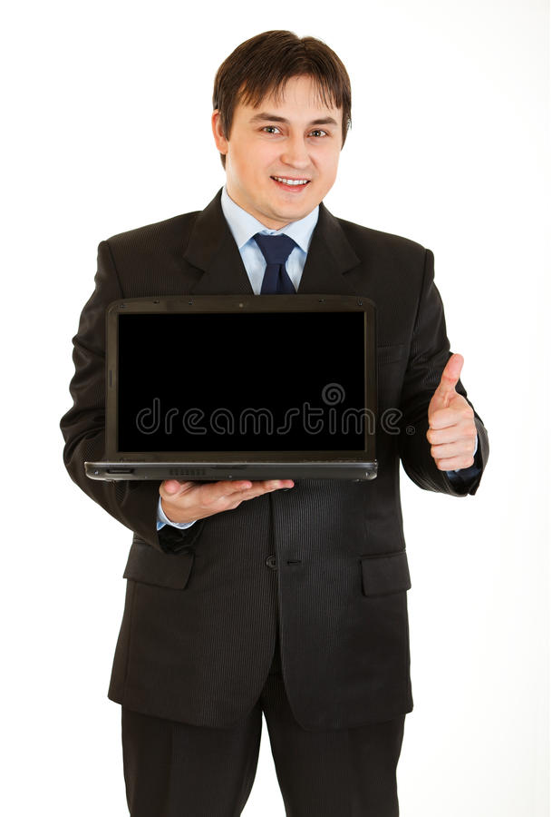 Download Young Businessman Holding Laptop With Blank Screen Stock Photo - Image: 17448998