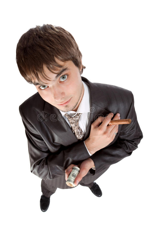 Young businessman holding money and cigar