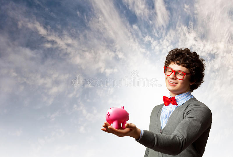 Young Businessman Holding Moneybox Royalty Free Stock Photo