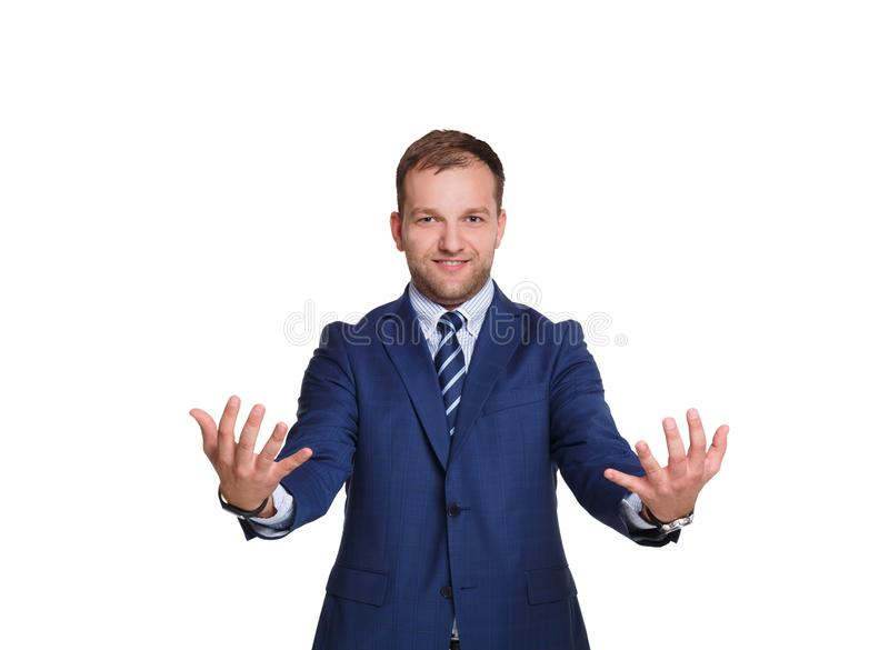 Young businessman holding some item with copy space isolated on white background royalty free stock photos
