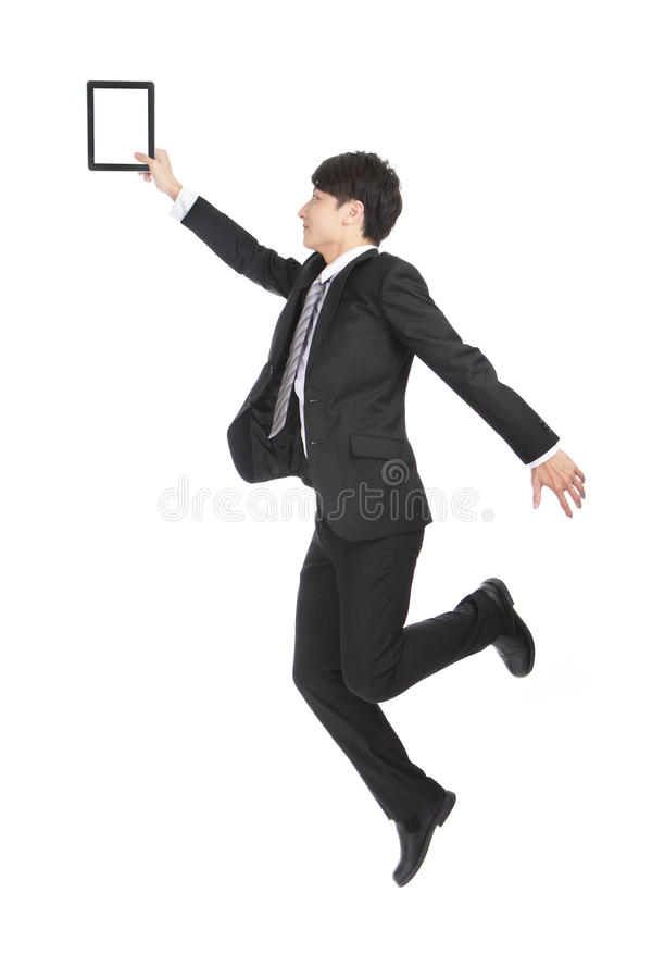 Young Businessman Holding Tablet PC Jumping stock images