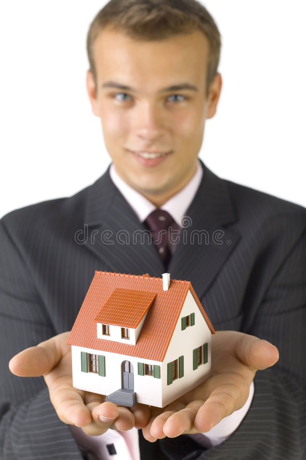 Young businessman with house stock photography