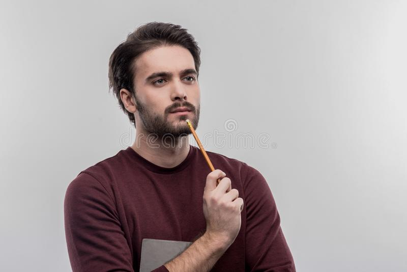 Dark-haired young businessman feeling inspired for new startup stock images